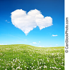 Valentines day. - Spring meadow and blue sky with a white...