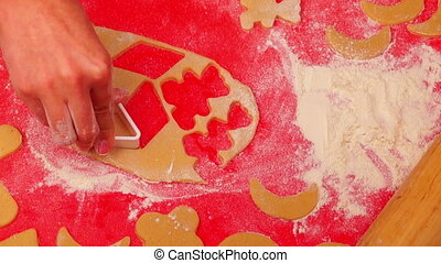 Cooking Christmas Cookies - Girl Cutting Christmas Cookies...