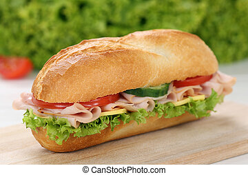 Sub deli sandwich baguette with ham, cheese, tomatoes and...