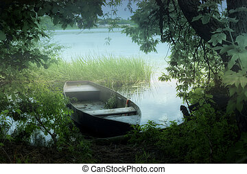 Silent river creeks - Old fisherman boat standing on the...