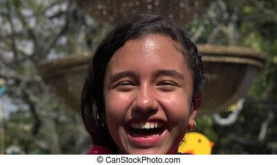Happy Teen Girl Laughing at Fountain