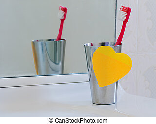 Bathroom sink with heart sticky note and toothbrush Love...