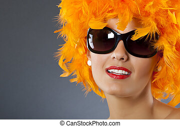 woman wearing feather wig - picture of a young pretty woman...