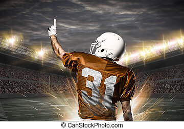 Football Player on a orange uniform celebrating on a...