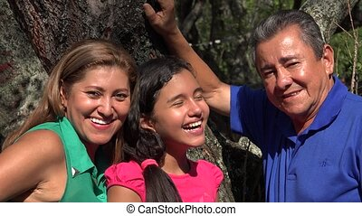 Family Posing at Tree in Public Park