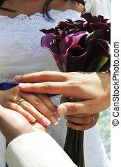 Wedding moment hands closeup - Groom gently strokinh hands...