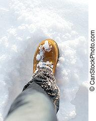 Men and 39;s boot in the snow in winter - Men39;s boot in...
