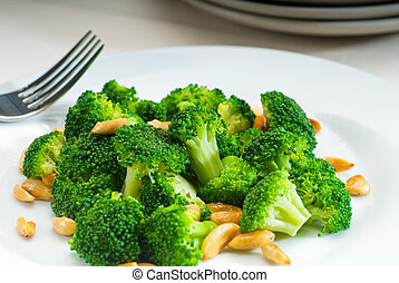 fresh sauteed broccoli and almonds - fresh and vivid sauteed...
