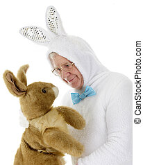 Easter Bunny Stare-Down - A senior man in a white rabbit...