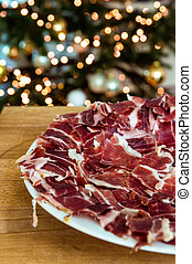 Iberian ham with a plate of slices of ham Typical Spanish