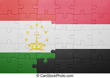 puzzle with the national flag of tajikistan and yemen ....