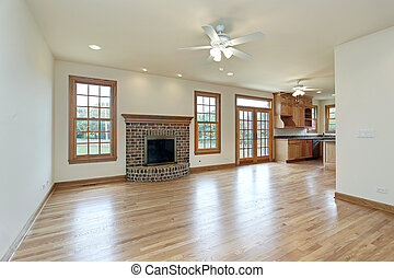 Family room with brick fireplace - Family room with kitchen...
