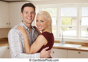 Young Couple In New Home Together