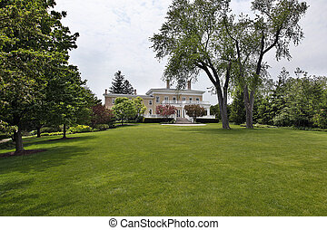 Large back yard of suburban home - Large back yard of luxury...