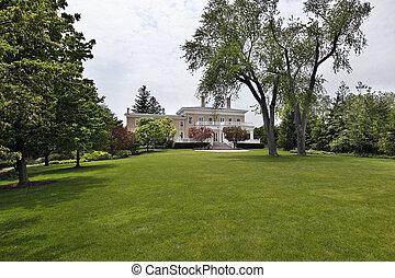 Large back yard of suburban home - Large back yard of luxury...