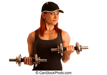 Beautiful young woman working out with dumbels in fitness...