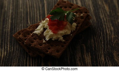Crispbread with soft cottage cheese and red pepper wood...