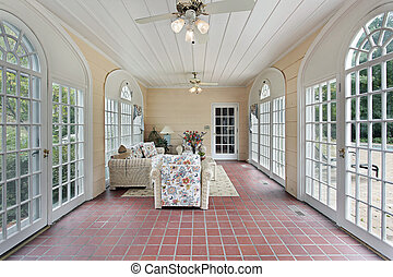 Porch with red brick floor - Porch in suburban home with red...