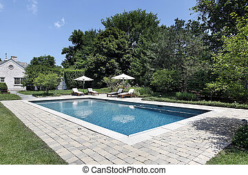 Swimming pool with deck chairs - Swimming pool of luxury...