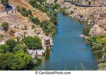 Toledo, Spain town skyline on the Tagus River