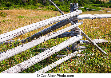 Dry wood log fence corner in long grass - Old diagonal dry...