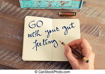Motivational concept with handwritten text GO WITH YOUR GUT...