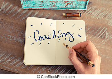 Motivational concept with handwritten text COACHING - Retro...