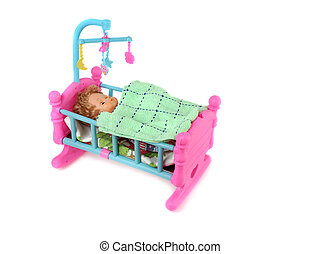 Baby Doll in Bed - Baby doll in toy bed isolated on white...