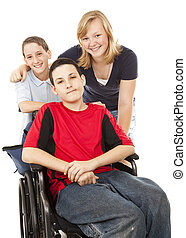 Disabled Boy and Siblings - Disabled boy in wheelchair with...