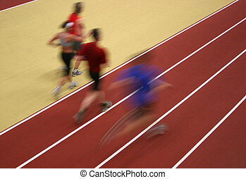 Runners - Motion blurred athletes competing on the track