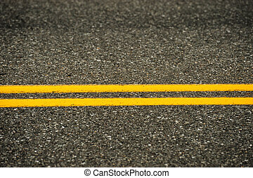 double yellow line on asphalt street surface