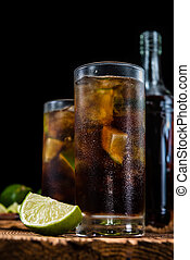 Homemade Cuba Libre with fresh lime, brown rum and crushed...