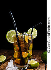 Fresh made Cuba Libre with brown rum and tasty lime
