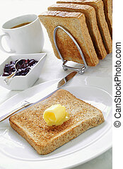 breakfast bread sliced wholemeal toast with butter jam and...