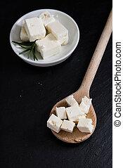 Feta Cheese on a slate slab - Portion of creamy Feta Cheese...