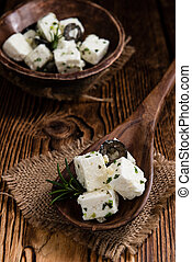Marinated Feta Cheese close-up shot on wooden background