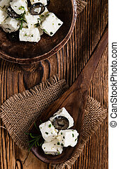 Greek Feta Cheese on rustic wooden background close-up shot...