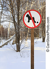 Sign forbidding dog walking in park. - Sign forbidding dog...