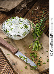 Fresh made Herb Curd (close-up shot) on vintage background
