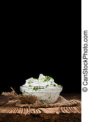 Herb Curd - Homemade Herb Curd in bowl close-up shot on...