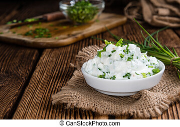 Herb Curd - Homemade Herb Curd in bowl (close-up shot) on...