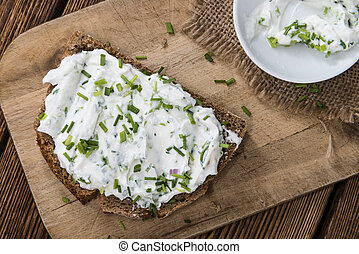 Slice of Bread with Herb Curd detailed close-up shot
