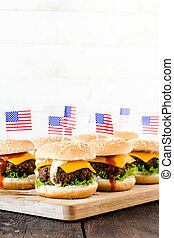 American cuisine - Mini beef burgers with American flag on...