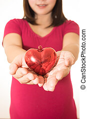 Woman show heart hands isolated on white