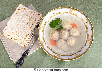 Chicken soup with Kneidlach (Matzah bolls) - A traditional...
