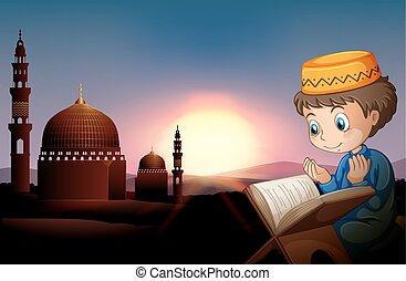 Muslim boy praying at mosque