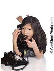 Girl talking on rotary phone, worried expression - Girl...