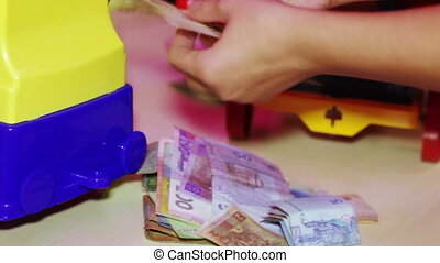 Counting collected money - Couple newlyweds believe money...