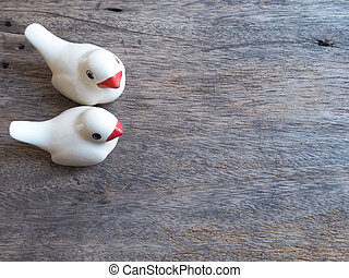 a pair of ceramic love birds on wood for Valentine's day...