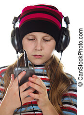 Girl with headphones listening to music. - Girl with...